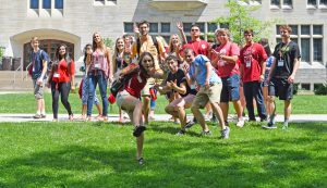 Group of students dance in a lawn