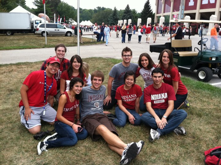 Group of friends posing for tailgating photo