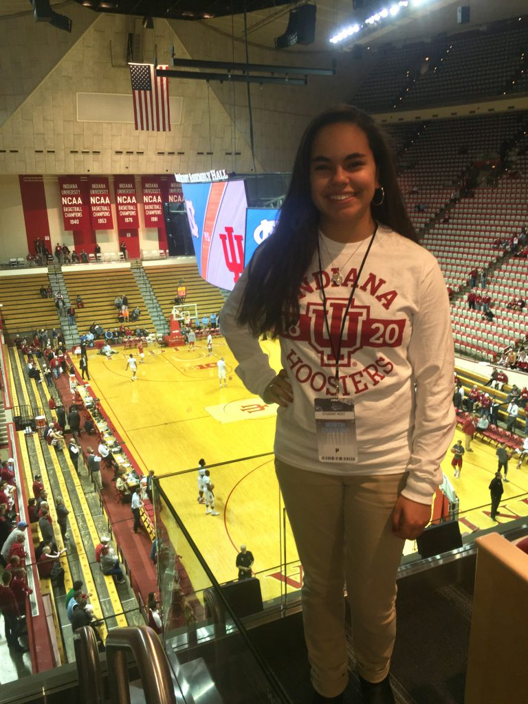 A cox scholar attending IU men's basketball stadium
