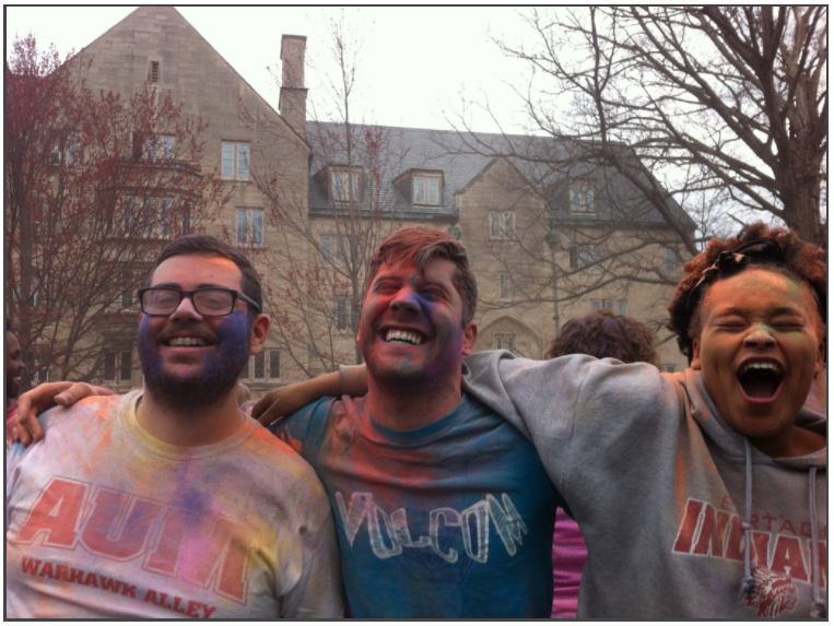 Three students enjoy the IU color day