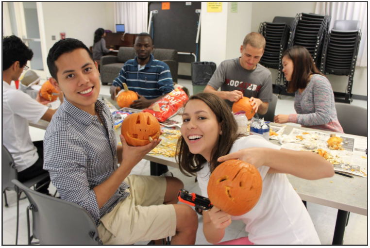 Students involved in pumpkin carving