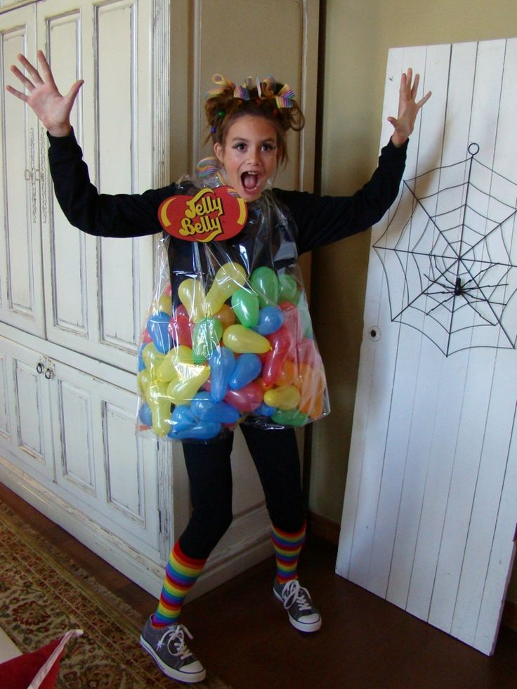 A girl in her halloween costume of jelly beans