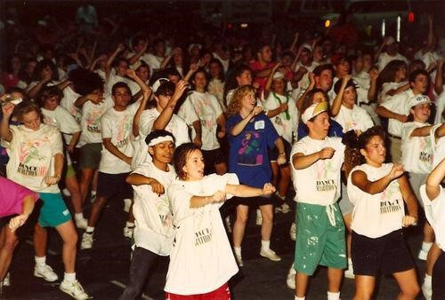 Old photo of people dancing for IUDM