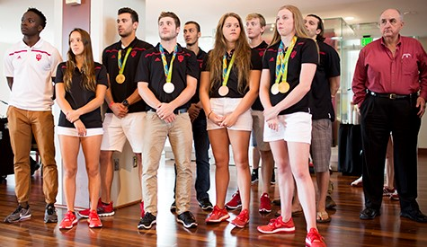 IU Olympians stand in front of crowd