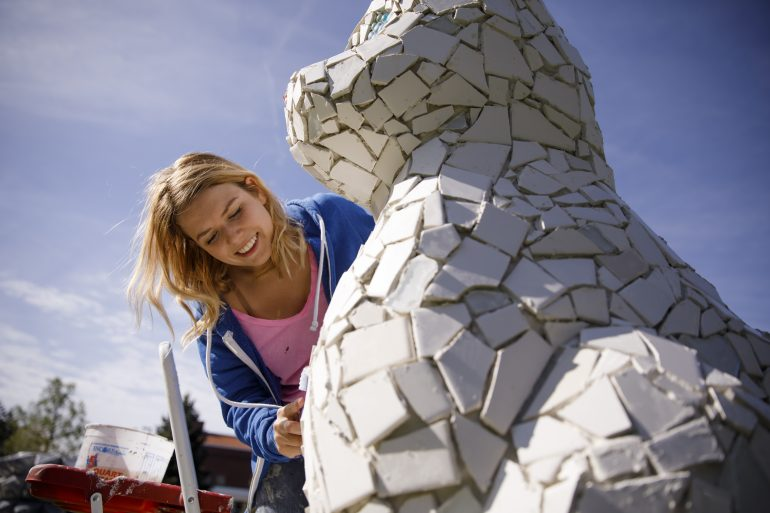 "Indiana University Bloomington Fine Arts student Kate Lasser works on her outdoor sculpture, ""Little Mister"", at the McCalla School on Tuesday, April 18, 2017."