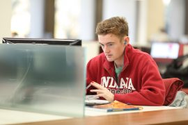 An IU Student works on computer