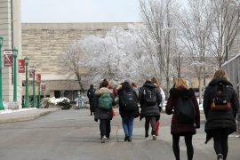 Sorority sisters walking to Wells Library.