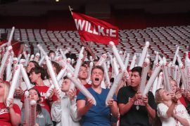 Students cheer with Wilkie banner