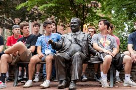 Students sitting around the Herman B. Wells statue