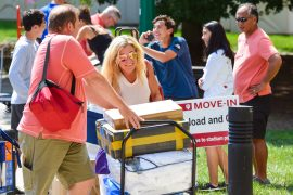 Parents helping move in their student