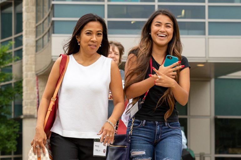 Friends walking on campus