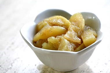 Sliced apples in a cup