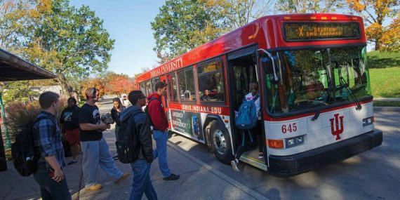Students getting on an IU campus bus