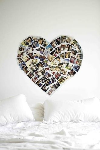 Pictures on a wall shapped into a heart