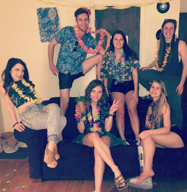 Friends dressed in island themed clothing