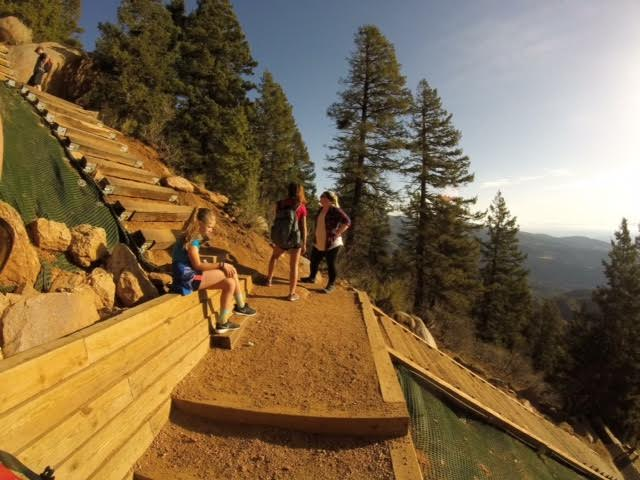 A group taking a break on a step stair case