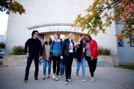 Students walk in front of an IU building