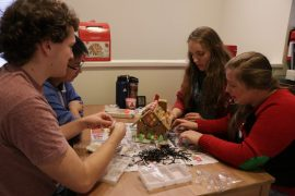 People building a gingerbread house