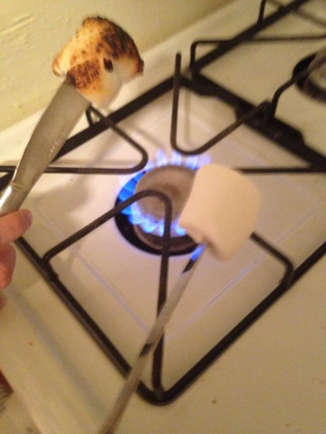 Marshmellow over a stove top
