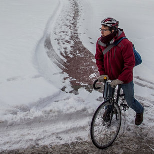 Person riding a bike in the snow