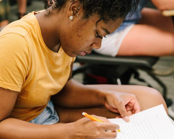 A student taking notes